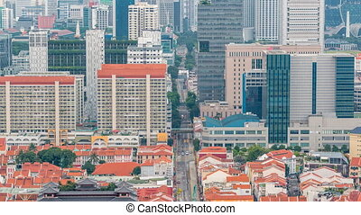 Aerial view of Chinatown and Downotwn of Singapore in the evening timelapse