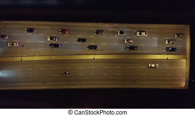 Aerial view of city at night with trafic and cars driving on the freeway and streets