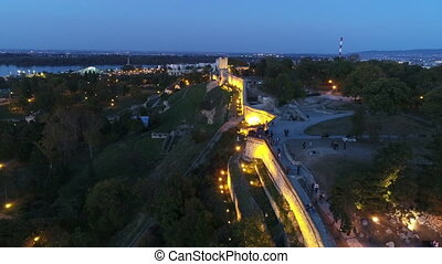 Aerial view of city fortress above wall in night 2