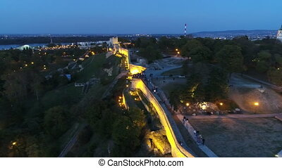Aerial view of city fortress above wall in night