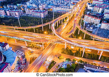 city interchange at night in kunming city - aerial view of ...