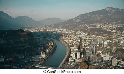 Aerial view of city of Trento, the Adige river and the Alps,...