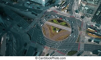 Aerial view of city roundabout traffic