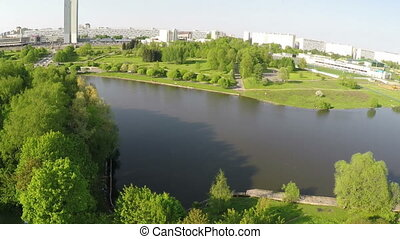 Aerial view of city with river and green parks, Moscow