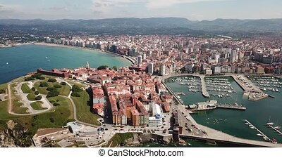 Panoramic aerial view of Gijon on Atlantic ocean coast overlooking of marina with moored pleasure yachts, Spain