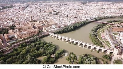 Aerial panoramic view of Mosque-Cathedral of Cordoba and Roman Bridge over the Guadalquivir