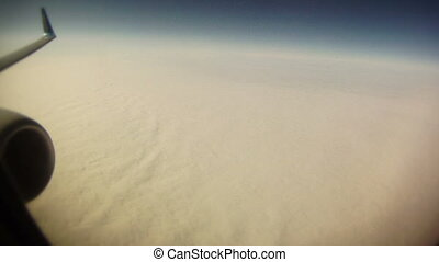 Aerial view of clouds from jet plane timelapse