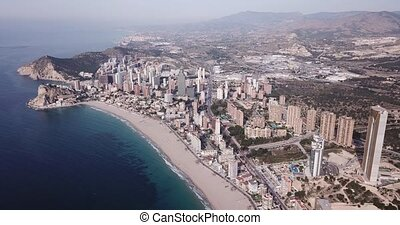 Panoramic aerial view of coast line at Benidorm with view of buildings and sea, Spain