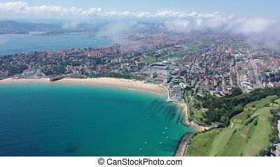 Panoramic aerial view of coast line and beach at Santander with apartment buildings, Cantabria, Spain