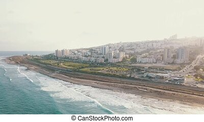 Aerial view of coast in Haifa. Urban top view with azure...