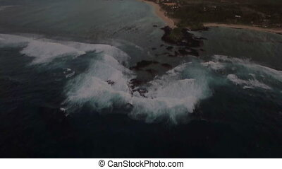 Aerial view of coast line of Mauritius Island, water laves...