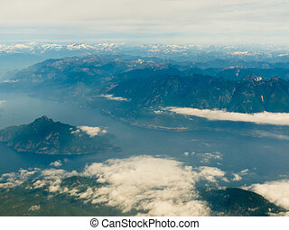 Aerial view of west coast mountain ranges and fiords of Pacific Ocean in western province of beautiful British Columbia, Canada.