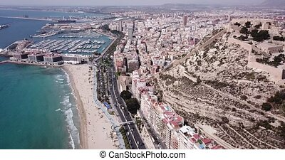 ALICANTE, SPAIN - APRIL 17, 2019: Panoramic view of Alicante sand beach, city and Santa Barbara castle