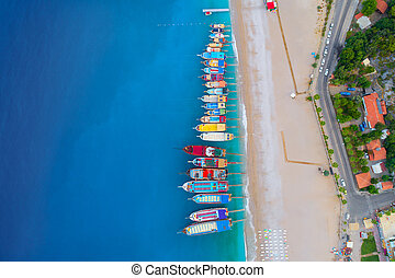 Aerial view of colorful boats in mediterranean sea