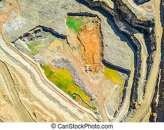 Aerial view of colorful, open pit mine