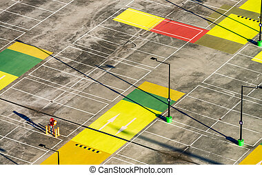 Aerial view of colourful empty city car parking