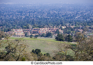Aerial view of condominium buildings surrounded by green areas, Cupertino, south San Francisco bay, California