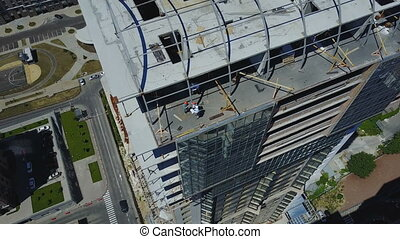 Aerial View Of Construction Site With Group Of Builders...