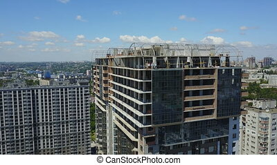 Aerial View Of Construction Site With Team Of Builders On...