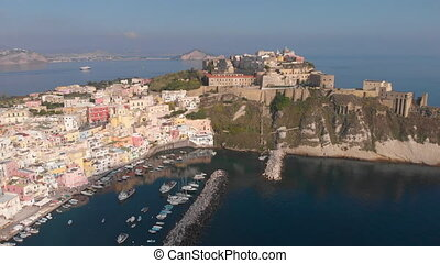 Aerial drone view of traditional Corricella fisherman village in Procida, island near Naples, Italy