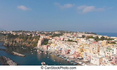 Aerial view of traditional Corricella fisherman village in Procida, island near Naples, Italy