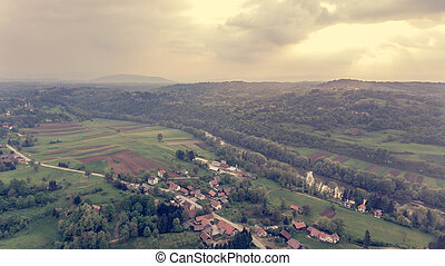 Aerial view of countryside at sunset.