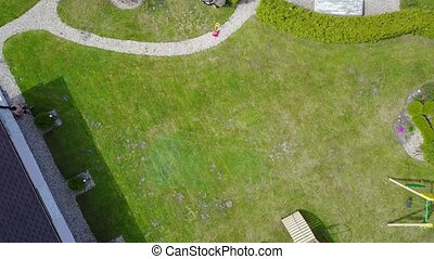 Aerial view of countryside, drone top view ascent on Latvian...