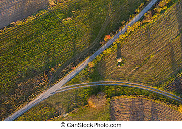 Aerial view of countryside road at autumn
