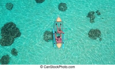 Aerial view of couple with dog in kayak - Aerial drone view...