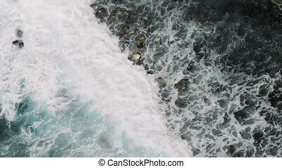 Aerial view of crashing waves in Tenerife, Canary Islands