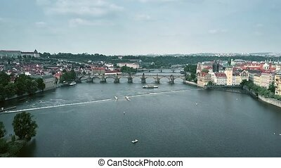 Aerial view of crowded famous Charles Bridge in Prague and...