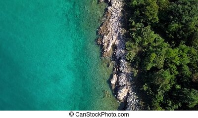 Aerial view of crystal clear water off the coastline...