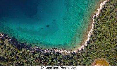 Aerial view of crystal clear water off the coastline inisland Krk, Croatia