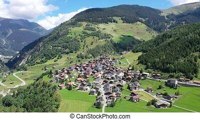 Aerial view of Curaglia village. Medel valley. Switzerland. High quality 4k footage