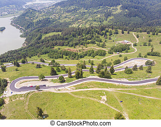 Aerial view of curvy road on mountain