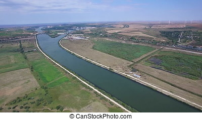 Aerial view of Danube river, windmills on the background, Cernavoda, Romania