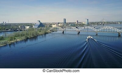 Aerial view of Daugava river in Riga day time. City landscape view from the air.