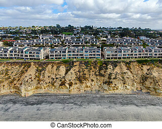 Aerial view of Del Mar North Beach, California coastal cliffs and House with blue Pacific ocean