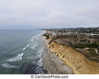 Aerial view of Del Mar North Beach, California coastal cliffs and House with Pacific ocean