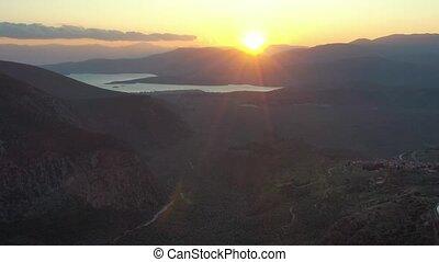 Aerial view of Delphi, Greece, the Gulf of Corinth, orange ...