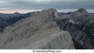 Aerial view of descending towards mountain ridge. Mojstrovka...