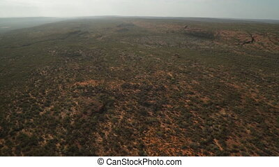 Aerial view of desert landscape, Outback, NT - Wide panning,...