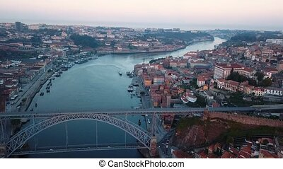 Aerial view of Douro river and Ribeira, Porto, Portugal. Flying over the old city center.