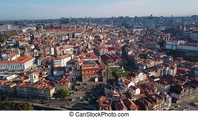 Aerial view of Douro river and Ribeira, Porto, Portugal. Flying over the roofs of the old city center.