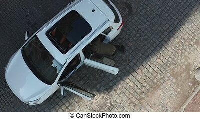 Aerial view of driver pulling criminal out of car - Drone...