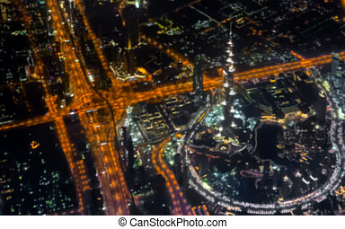 Aerial view of Dubai city night cityscape blur abstract background