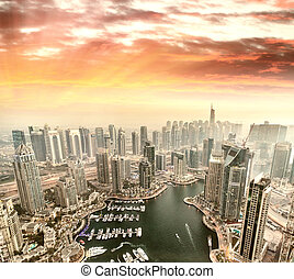 Aerial view of Dubai Marina from a vantage point at sunset.