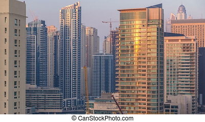 Aerial view of Dubai Marina from a vantage point at sunset...
