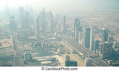 Aerial view of Dubai's skyscrapers on a hazy day, UAE