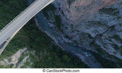 Aerial view of Durdevica Tara arc bridge in the mountains,...